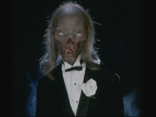 Tales from the Crypt wallpaper probably with a business suit and a dress suit entitled Behind