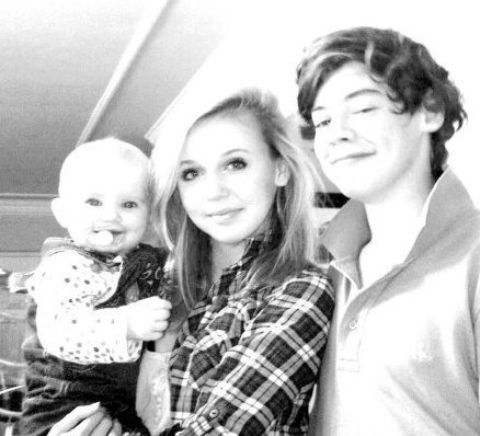 Harry Styles wallpaper probably containing a portrait titled Flirty Harry With His Ex Girlfriend Felicity and Baby