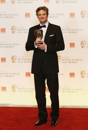 Colin Firth wallpaper with a business suit, a suit, and a well dressed person called Colin Firth in Bafta awards 2011