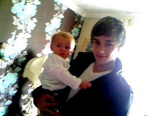 Goregous Liam Holding A Very Cute Baby (Aww Bless) 100% Real :) x