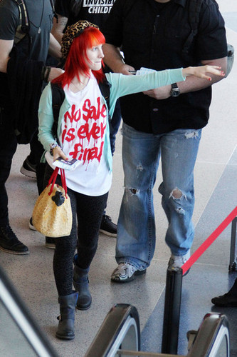 Paramore arrive at LAX for their flight to NYC