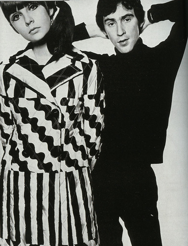 The 60's wallpaper probably containing an outerwear titled Mod fashion