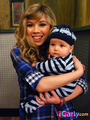 Sam holding a random baby - samantha-puckett photo