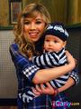Sam holding a random baby