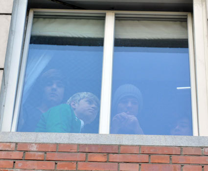 one direction in dublin peeping out the window!
