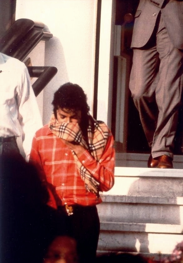 Michael Jackson wearing a burberry scarf