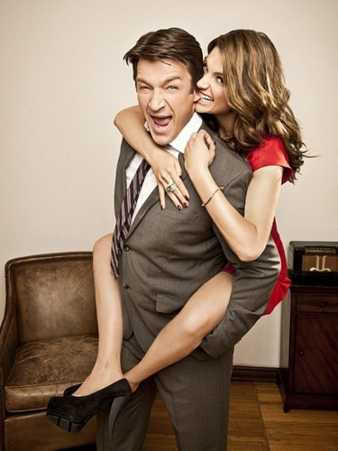 Nathan Fillion & Stana Katic wallpaper possibly containing bare legs, a hip boot, and a well dressed person called Stanathan - TV Guide <3