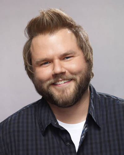 Tyler Labine is Larry