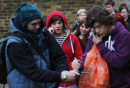 Harry + Louis getting mobbed! :P xx
