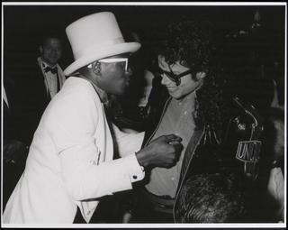The Bad Era achtergrond possibly with a green beret, baret titled MICHAEL JACKSON WITH FLAVA FLAV