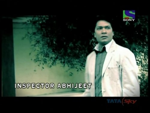 CID wallpaper probably containing a business suit and a portrait titled abhijeet