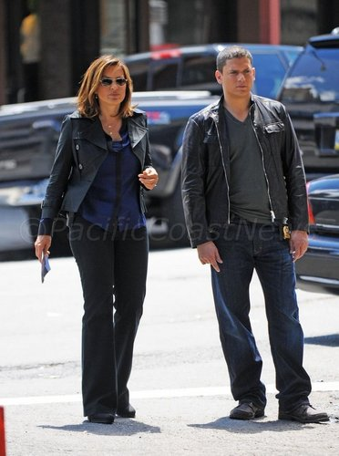 Wentworth Miller Hintergrund with a business suit, a street, and a well dressed person entitled law and order