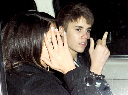 Justin Flips off Photogs