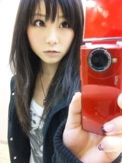 Rina & her phone!! X3