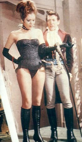Diana Rigg kertas dinding containing tights, a leotard, and a hip boot titled The Queen of Sin