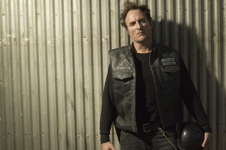 Sons Of Anarchy wallpaper possibly with a business suit, a green beret, and fatigues entitled Tig Trager