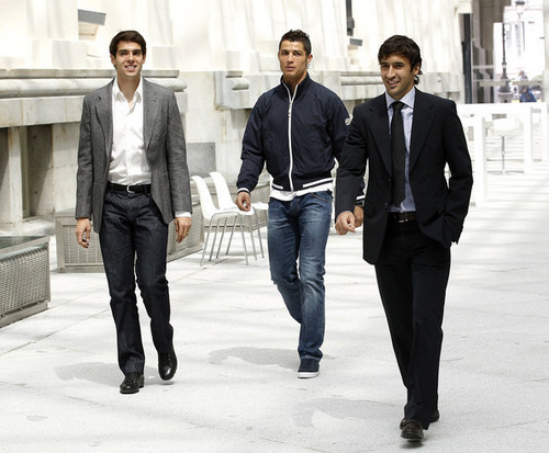 Cristiano Ronaldo and Ricardo Kaka Обои containing a business suit, a well dressed person, and a suit called Cristiano Ronaldo & Kaka