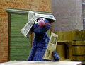 Grover the Newspaper Salesman