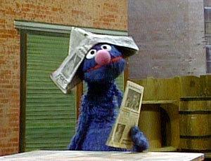 Grover the Newspaper Salesman