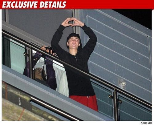Justin Bieber on his balconey in Liverpool, UK