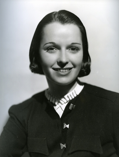 Louise Brooks 바탕화면 with a business suit, a suit, and a well dressed person titled Miss Brooks
