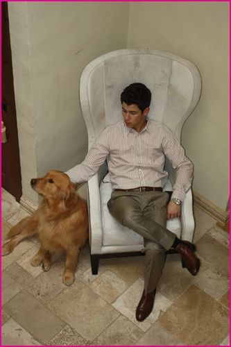 Nick Jonas Hangs Out With His Dog Elvis