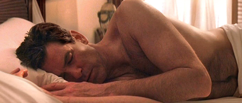 PIERCE BROSNAN SHIRTLESS SLEEPING.