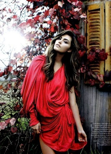 Phoebe Tonkin as Faye in red