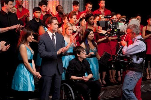 "Glee wallpaper with a business suit and a well dressed person titled ""Original Song"" - behind the scenes"