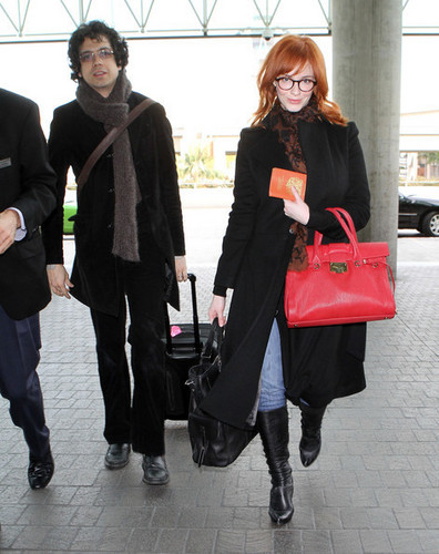 Christina Hendricks And Geoffrey Arend Catching A Flight At LAX