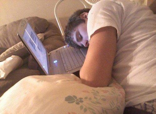 Justin sleeping on his laptop x)