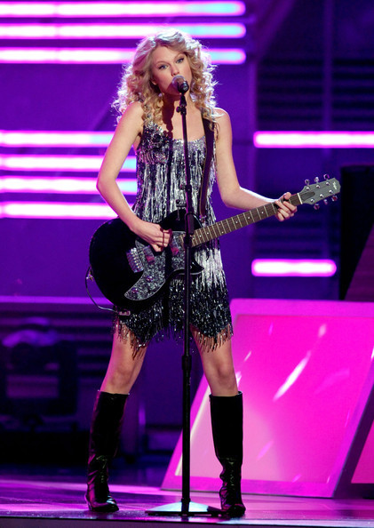 Taylor Swift wearing cowboy boots