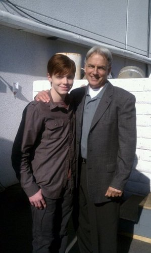 behind...Mark Harmon