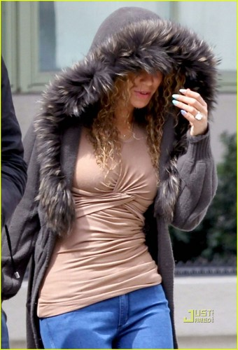Beyonce Hides Under Her hud, hood