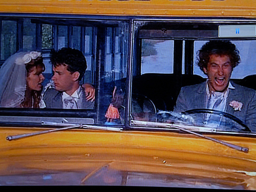 Tom Hanks achtergrond probably with a school bus titled Bachelor Party