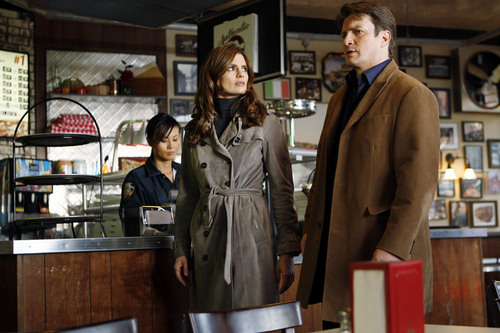 Kate Beckett karatasi la kupamba ukuta probably with a trench coat, a box coat, and an overgarment called Castle_3x20_Slice of Death_Promo pics