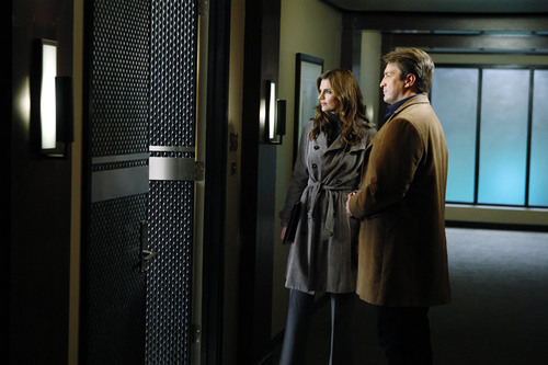 Kate Beckett karatasi la kupamba ukuta probably with a revolving door titled Castle_3x20_Slice of Death_Promo pics