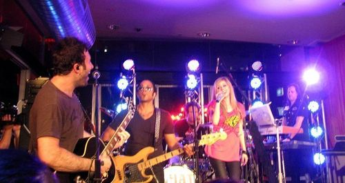 avril lavigne wallpaper with a konser and a guitarist titled March 30 2011 - 2DayFM Rooftop Sydney, Australia Live