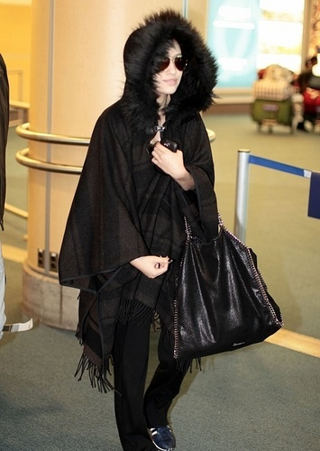 02.04 - Christian Serratos at Vancouver airport