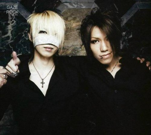 The Gazette achtergrond probably containing a well dressed person and an outerwear entitled Aoi and Reita