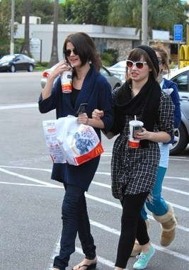 Demi Lovato & Selena Gomez peminat-peminat kertas dinding with a street, a carriageway, and a business suit called McDonalds Bud!-1