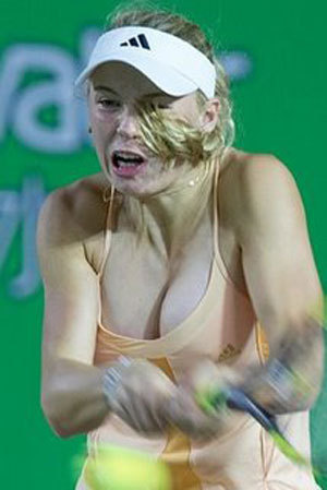 Tennis wallpaper possibly containing a tennis pro, a tennis racket, and a tennis player entitled caroline-wozniacki-breasts