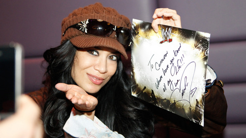 Melina Perez Hintergrund probably with a sign and a tamale titled meLina