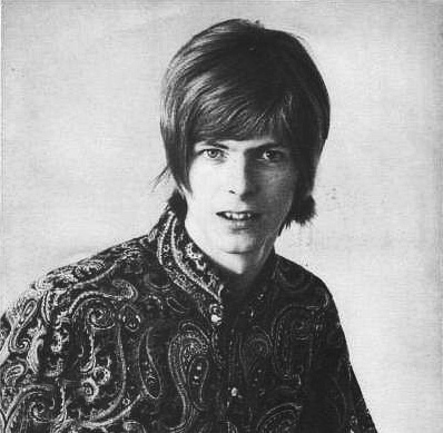 http://images4.fanpop.com/image/photos/20700000/-David-Bowie-1967-lilac-skies-20760680-398-389.jpg