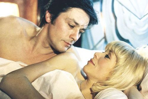 Alain Delon wallpaper probably containing a neonate and skin titled Alain Delon and Mireille Darc