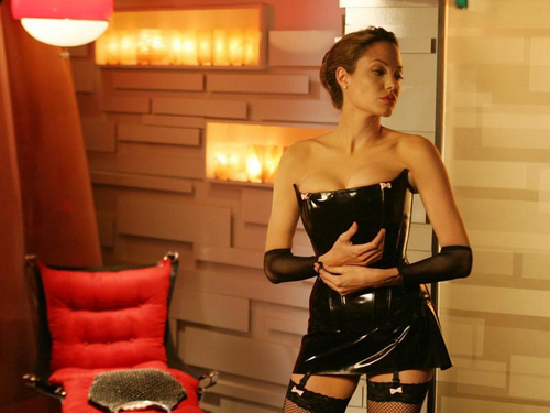 Angelina Jolie wallpaper possibly with a hip boot, tights, and a chemise called Angelina Jolie