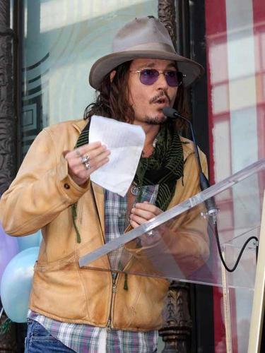 Johnny Depp wallpaper possibly with a sign and a street entitled Johnny Depp and Penelope Cruz  Hollywood walk of fame