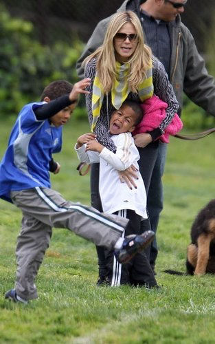 March 30: Taking her kids and dogs to a park