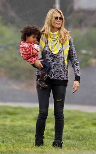 March 30: Taking her kids and chó to a park