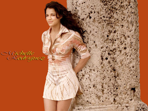 Michelle Rodriguez hình nền probably with bare legs, a cốc-tai, cocktail dress, and a chemise entitled Michelle Rodriguez